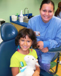 Figure 4 Dental assistant Jessica Rivas with a smiling patient from Children's Dental Services.