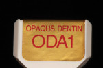 The opacious dentin build-up should comprise a larger volume than fired porcelain as it helps to create a more dense gingival and body shade.