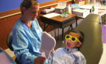 Tufts University School of Dental Medicine works to educate under-insured children about their dental health.
