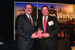 Don Albensi, Sr. accepts Albensi Dental Laboratory's Top Work Places 2013 Award.