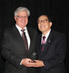 Dr. Baldwin Marchack (right) presents Robert Kreyer, CDT (left) with the American Prosthodontic Society's Rudd Award.