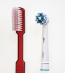 Figure 1 The study test products: novel oscillating-rotating brush head with angled bristle tufts (right) and flat-trim manual toothbrush (left).