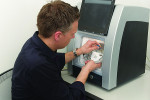 Fig 1. Alexander Wunsche, CDT, inserts a Ceramill Zolid FX blacnk into a Ceramill Mikro mill at Zahntechnique.
