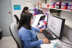Fig 1. A G&H Dental Arts technician digitally designs a case that was submitted via a 3M True Definition Scanner.