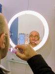 Author using Oral-B Genius Pro intelligent brushing system.