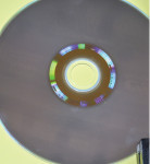 Fig 15. Light interference is noted with compact disc reflecting white light into its colors.