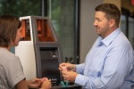 Andy Johnston, CDT, explains Kulzer's cara Print 4.0 3D printer. Johnston is part of a dedicated support team that goes above and beyond to help its customers.