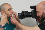 Fig 1. Photographing the patient with a white-balance Gray Reference Card.