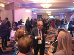 More than 700 dentists attended the Glidewell Dental Symposium, including keynote speaker Jack Hahn, DDS, pictured talking to other attendees.