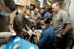 Figure 2  HELMAND, PROVINCE, Afghanistan —U.S. Navy Lt. Sarita Ojha, a dentist with 1st Dental Detachment, Charlie Surgical Company, Combat Logistics Regiment 15 (Forward), 1st Marine Logistics Group (Forward), performs a root canal on a military w