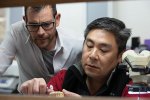 Fig 1. Jack Marrano, CDT, works on a case with Jimmy Loo of Absolute Dental's Art Team. Marrano believes the best way to gain technicians' trust and respect is to work alongside them.