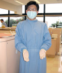Figure 2  Long-sleeve gowns or lab coats are appropriate for most dental procedures.
